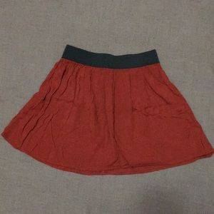 Rust orange rayon skirt with stretchy waist!